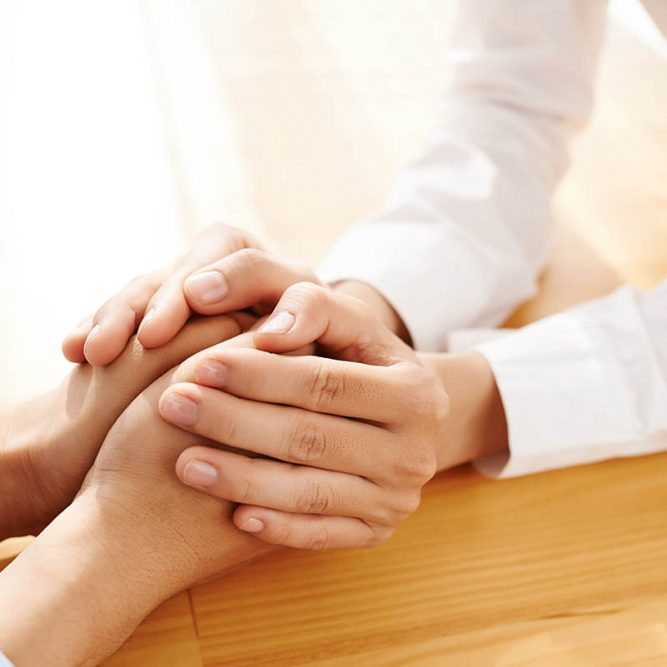 Hands of woman reassuring her colleague